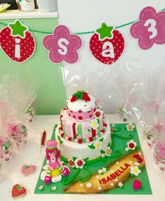 Cake and cookies at a Strawberry Shortcake birthday party! See more party ideas at CatchMyParty.com!