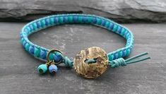 Blue and green leather and beaded bracelet with antique gold button £10.00
