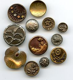 SOLD: Antique and vintage floral plant life group of metal buttons