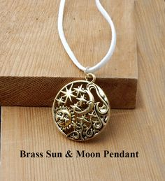 Sun Moon and Stars Brass Pendant. Brass pendant depicting sun, moon and stars hanging on 20 inches white leather.  Gift for him or her. by BettyCampbell on Etsy