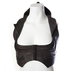MAYA COBRA TOP      DESCRIPTION  Soft pleated leather top with Python skin collar. Form fitting and supportive edgy top. Very versatile and great for every occasion. Perfect complement for the Urban Mayan leather wrap.