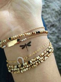 love these bracelets and the cute little dragonfly tat