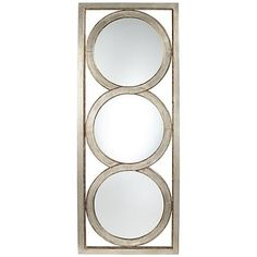 A contemporary metal wall mirror with a distressed champagne finish in the outer frame that surrounds three fused beveled mirrors.