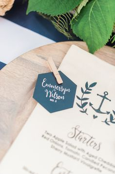 Unique wedding place card idea - hexagon-shaped cards with modern hand calligraphy attached to menus with clothespins {Stephanie Barnes Photography}