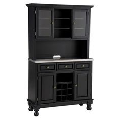 Add a traditional touch to your kitchen or dining room with this beautiful china cabinet. A top hutch features 2 glass doors for stowing stemware, while 3 sp...$742- slightly deeper
