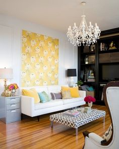 This is my style to a T. Lots of fun pillows, chandelier, gold and silver mixed, fun trellis print, black and white, lots of color, A little bit of everything.