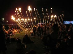 Pyrocardium by False Profits installed at both Electric Daisy Carnival and Coachella 2009.  The art crew would hook up a monitor to a fan's heartbeat and the fire sculpture would shoot fire accordingly in a circular fashion.