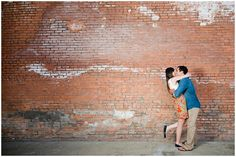 McKinney Cotton Mill Casual Engagement Photo Session in front of a brick wall by…