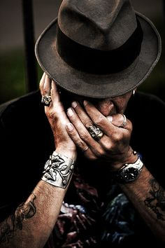 A man plays harmonica. Shot by Jeff Fillmore. Pinned via Flickr