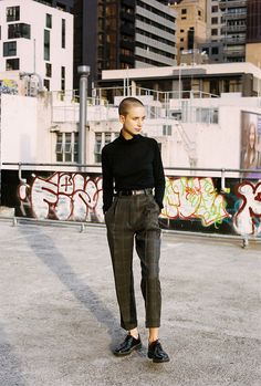Iffy about the shoes, love shaved head + turtleneck + tapered trouser.