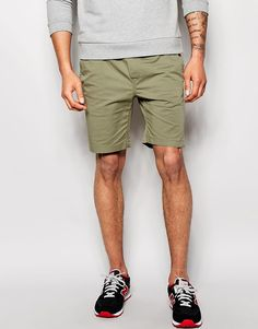 """Chino shorts by Solid Canvas fabric Contains stretch for comfort Drawstring waistband Two front and two back pockets Straight fit - cut with a straight leg Machine wash 98% Cotton, 2% Elastane Our model wears a size Medium and is 188cm/6'2"""" tall"""