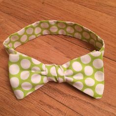 A lovely bow tie made from a fun line green and white pattern cotton fabric. Wonderful for weddings, parties, the holidays and just for fun!  All bow ties are machine washable and hang dry. Make are to press the bow tie before wearing. One must always look dapper!  Choose the size that fits your neck, or choose to have a clip-on bow tie.  All bow ties are made to order, and will need to be made to fit your size and style.