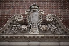 From 1896, a VERITAS shield on the exterior of what was once the Fogg Museum and is now the Harvard Art Museum