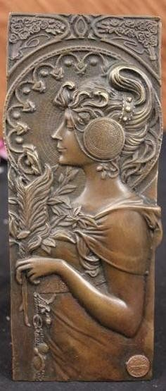 Mucha; Art Nouveau bronze bas relief plaque : Lot 110Av.  bronze plaque, Art Nouveau girl after Alphonse Mucha, signed; 9.5in. H. x 4in.  est. $200-$300