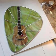 Guitar In Pick - Delphi Artist Gallery