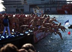 Athletes leap into the Mediterranean sea as they take part in the Copa Nadal in the northern Spanish port of Barcelona, Spain. The Copa Nadal (Christmas Cup) is a traditional swimming competition that takes place in Barcelona every December 25th, where participants swim 200 meters in the open sea in the port of Barcelona. (AP Photo/Emiliio Morenatti)