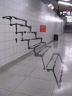 These stairs were spray painted by a guy in the subway to appear as an illusion of the stairs coming out of the wall.