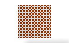 Vicoustic's Stylo pattern with white frame and orange fabric.