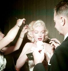 Marilyn Monroe getting ready for her appearance on...