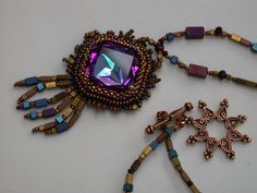'Contemporary Empress' Vintage (discontinued) Square Swarovski Fancy Stone in Heliotrope, seed beads, heated hematite beads