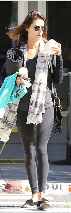 Who made  Alessandra Ambrosio's black legging, stripe white scarf, sunglasses, black suede handbag, and shoes?