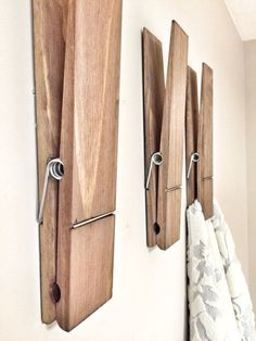 Giant clothes pins instead of hooks is such a genius way of mixing wall décor with practicality.