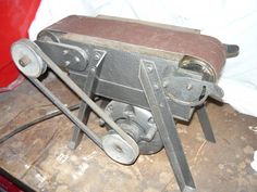 Grinding by brightspark -- Homemade grinding machine utilized for surface finishing. Constructed on a steel frame and powered by an electric motor. http://www.homemadetools.net/homemade-grinding