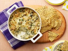 This Kale and Artichoke Dip has all the warm creamy goodness of party-favorite spinach artichoke dip, but with far fewer calories and fat.