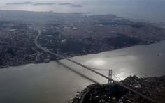 Bosphorus bridge is pictured through the window of a passenger aircraft over Istanbul, Turkey, January 10, 2016. REUTERS/Murad Sezer/File Photo