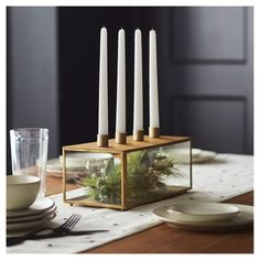 Easily refresh your dining room table or mantel with this Glass and Metal Taper Candleholder from Hearth & Hand™ with Magnolia. This sturdy brass and glass taper candleholder features a see-through box design with four taper candleholders on top. The simple and clean design creates a dynamic, visually interesting piece of decor that channels traditional style with a hint of modern flair. You'll instantly add a warm and inviting feeling to any living space with this glass box ...