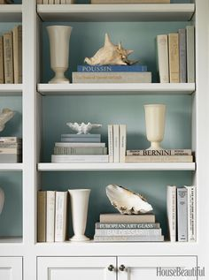 Restyle your bookcase. Strip off those garish dust jackets and paint the back wall of the shelf a calm hue to make it all pop.