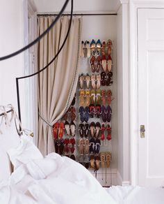 Pin for Later: 9 Shoe Storage Ideas That Don't Require Closet Space Concealed With a Curtain Turn an awkward alcove into a makeshift closet by adding a hanging shoe rack, curtain rod, and drapes. Hidden Storage, Wall Storage, Shoe Storage, Storage Spaces, Shoe Racks, Vertical Storage, Bedroom Storage, Extra Storage, Makeshift Closet