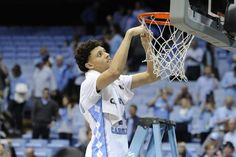UNC vs Duke Justin Jackson (44) cuts down the net as the Tar Heels have clinched the regular season ACC Champions following NCAA basketball action at the Dean E. Smith Center between the North Carolina Tar Heels and the Duke Blue Devils on March 4, 2017 in Chapel Hill, NC.
