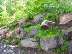 Boulders can stabilize a slope well, but they should be assembled in such a way as to make it look like they've always been there and that the drive or walk or patio have been made to appear that they've been placed around those boulders. To do that, they should vary in size, mostly large and mimic how they would have come to settle over centuries.