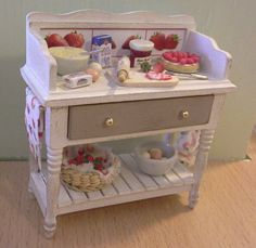 Dollhouse table to make a delicious strawberry pie made by Jolanda Knoop