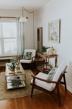 """Don't feel the need to buy everything all at once. We've rearranged our home three times at least, and after two years finally found a layout we love with pieces we've been collecting for more than three years."""