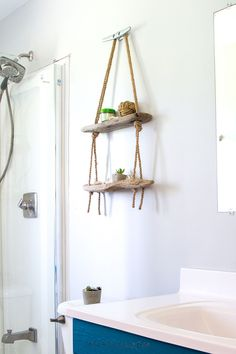 Learn how easy it is to make a DIY hanging rope shelf. It's the perfect nautical wall decor idea for the lake house or cottage!