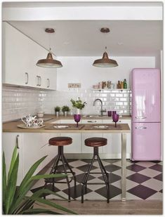 Pink fridge and checkered floor in the kitchen set the tone, here we are in the 50s In this Madrid apartment, spaces were redistribute...