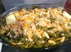 Our Famous Green Bean Casserole   Ingredients  4 cans of green beans  2 sleeves of Ritz crackers 1 stick of butter Directions Place 2 cans of green beans in baking dish Top with 1 sleeve of ritz crackers  then 1/2 stick of butter sliced  repeat 1st step then bake at 350 for 30 minutes