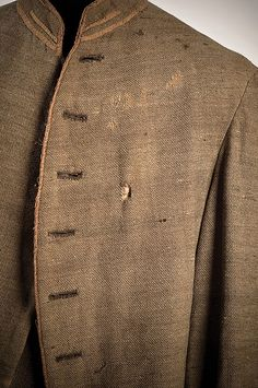 Uniform worn by James Wiley Gibson (Orangeburg, SC), who was killed at the Battle of Secessionville, SC, June 16, 1862. The bullet entry hole is visible at the left breast. The coat and trousers are likely a product of the Porter Industrial School for Girls in Charleston. Charleston Museum.