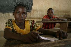 Young boy and girl attending primary school in Betoko by hdptcar, via Flickr