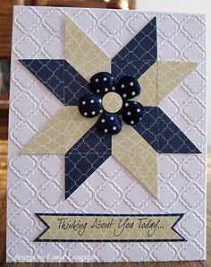handmade quilt card ... star pattern from triangles ... on top of embossed layer ... luv the polka dotted flower that sits on top of the star ...