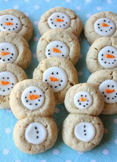 Thumbprint Snowman Cookies these would be easy placing a white chocolate disc on top while warm and then when cool  a little royal frosting or a food edible ink marker .