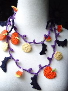 Crochet Halloween Bats Lariat Necklace by meekssandygirl, via Flickr  Made from cashmere yarn on a purple base with black bats, candy corn, pumpkins, and yellow moons. Has a self loop and toggle in the back for closure. Long enough to wrap around a couple times.    Measures 48 inches long. Bats are 1 1/2 inches wide.
