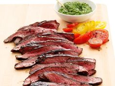 Slather slices of budget-friendly flank steak and summer-ripe tomatoes with a parsley-and-scallion salsa verde.
