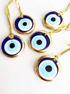 A personal favourite from my Etsy shop https://www.etsy.com/listing/511754165/gold-evil-eye-beads-50-pcs-unique