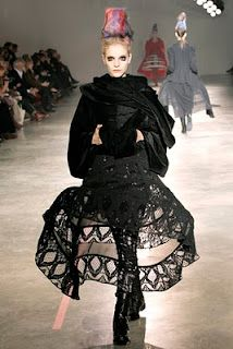 i believe this is designed by Comme des Garcons ... i adore the crinoline idea coming through the skirt, love it!