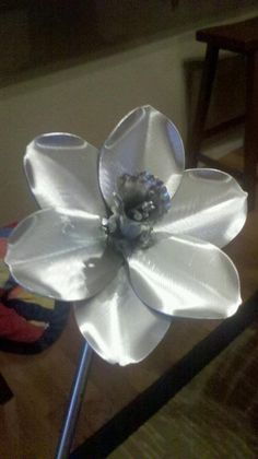 My husband made a aluminum daffodil for me. The daffodil is the 10 year anniversary flower and aluminum/ tin is the 10 year material because its flexible.