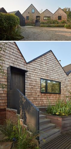 This modern house is covered in wood shingles, and planter boxes hide the ramp leading to the front door.
