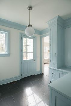 Powder blue mudroom features powder blue cabinets fitted with a powder blue L shaped bench alongside a black staggered tile floor illuminated by a white glass globe pendant. L Shaped Bench, Blue Cabinets, Blue Rooms, White Houses, Interiores Design, Mudroom, Laundry Room, Home Remodeling, Living Room Designs
